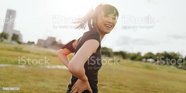 Female runner laughing on field in morning picture id596086200?b=1&k=6&m=596086200&s=612x612&h=xctbvcfuaazib  votw5jq1f97s jqi5ddgtsk1zesc=