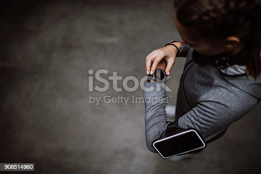 istock Female runner looking at smart watch heart rate monitor 906514960