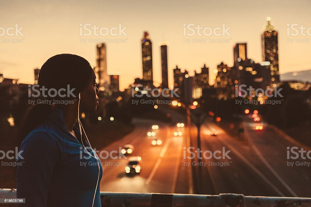 female runner looking out to the skyline stock photo
