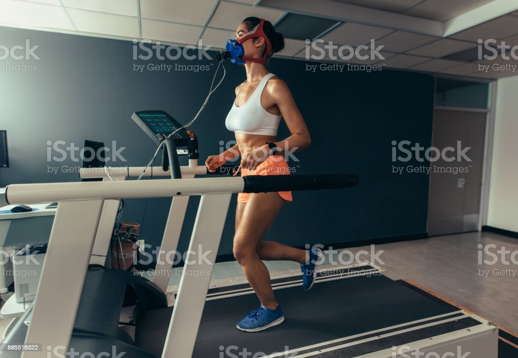 Female runner on treadmill at biomechanics lab stock photo