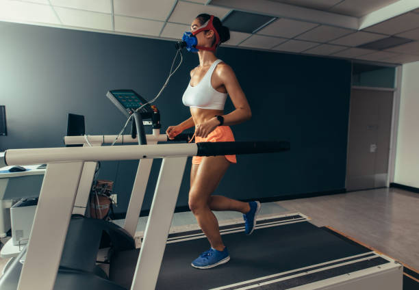 Female runner on treadmill at biomechanics lab stock photo