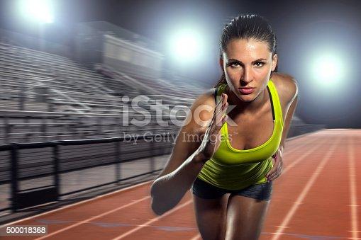 istock Female runner sprinter exercising training intense track field athlete sports 500018368