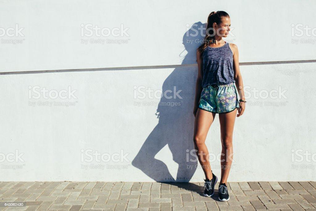 Female runner standing outdoors stock photo