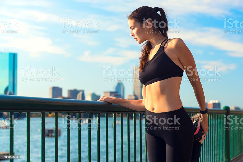 Female Runner Stretching While Enjoying the View in Boston, USA stock photo