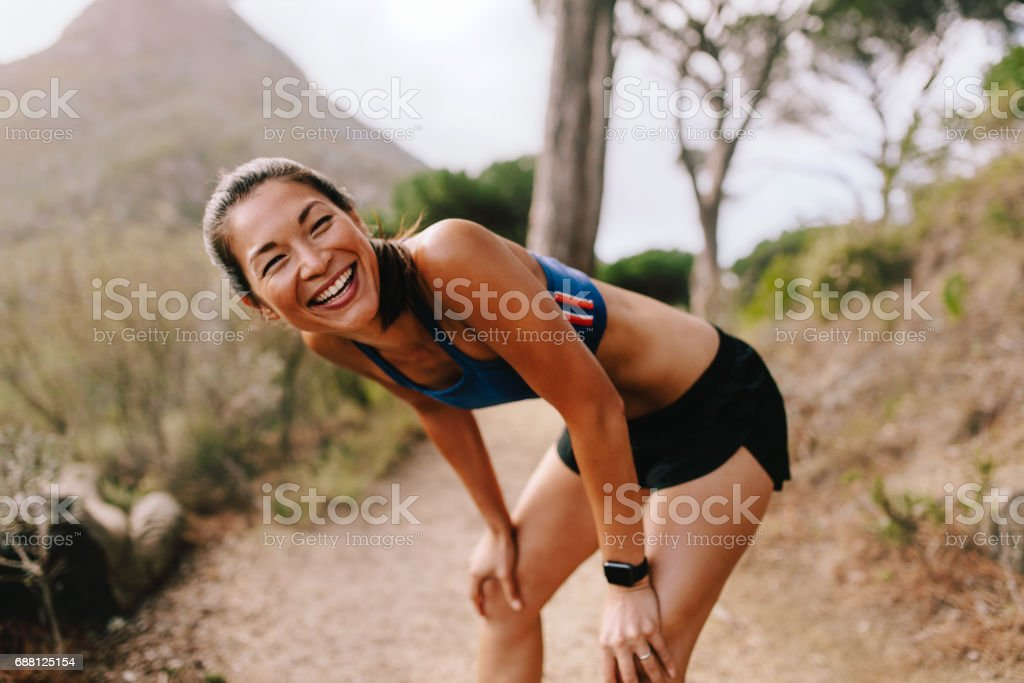 Female runner taking a break after workout stock photo