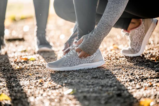 Weibliche Läufer Binden Sportschuh – Foto
