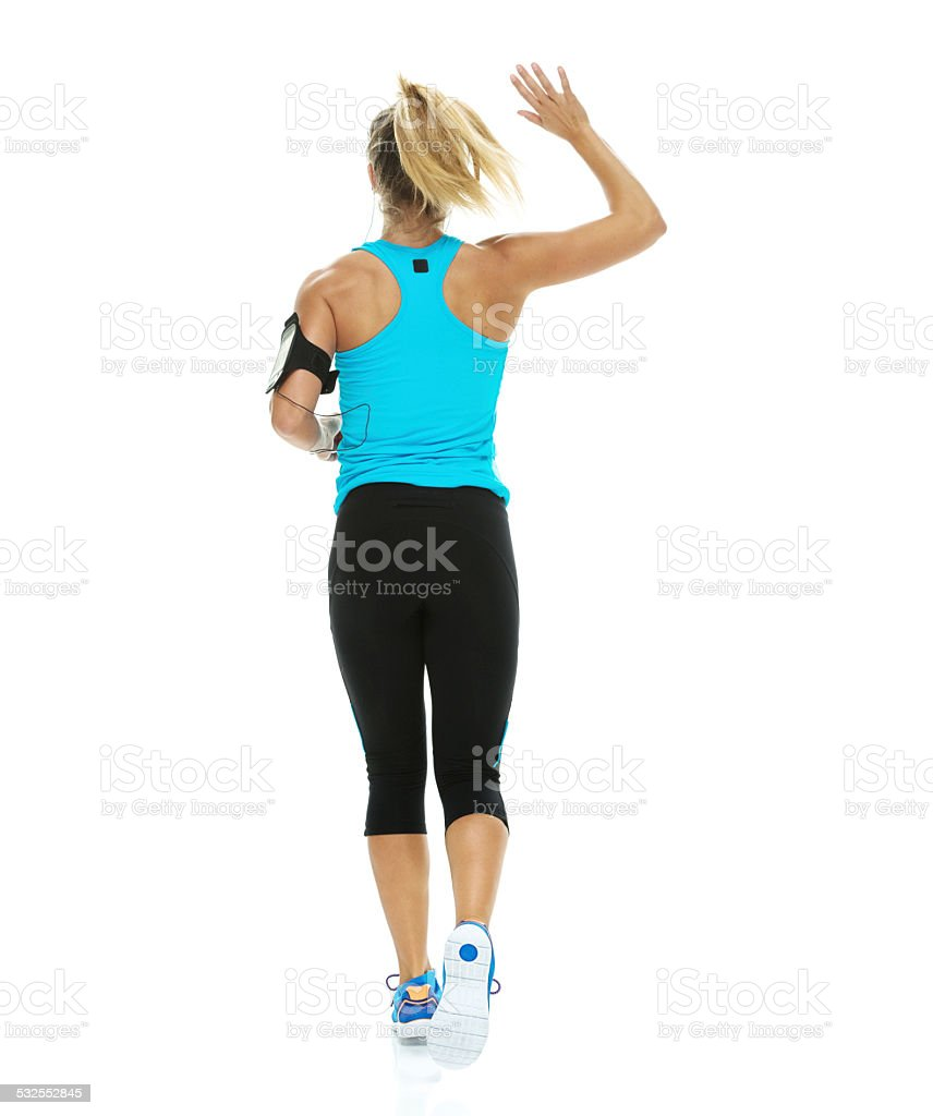 Female runner waving hand stock photo