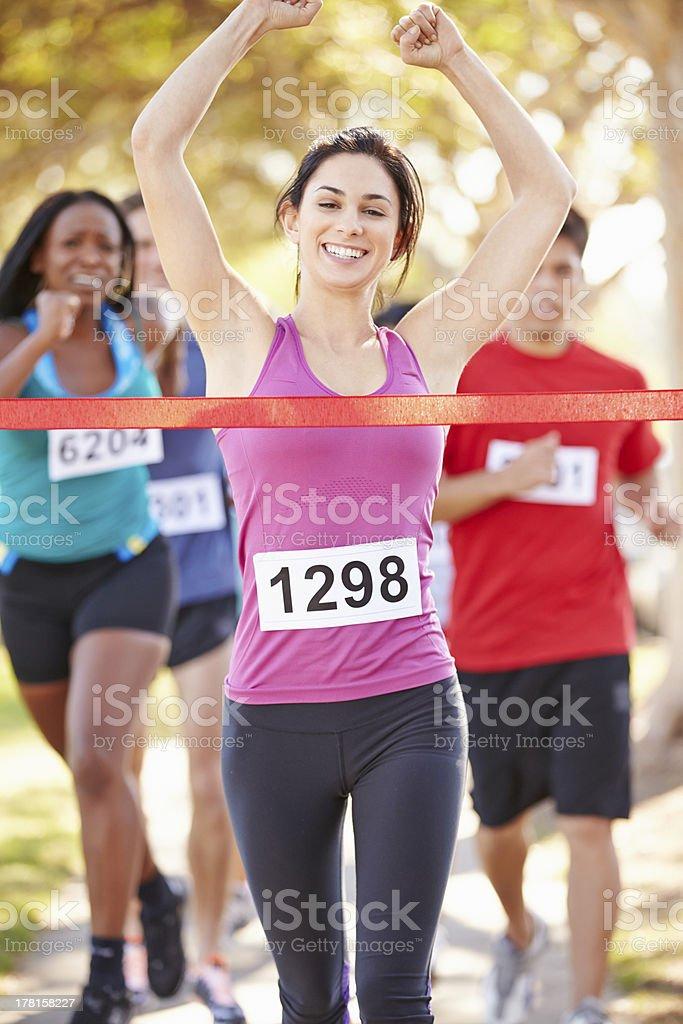 Female Runner Winning Marathon stock photo