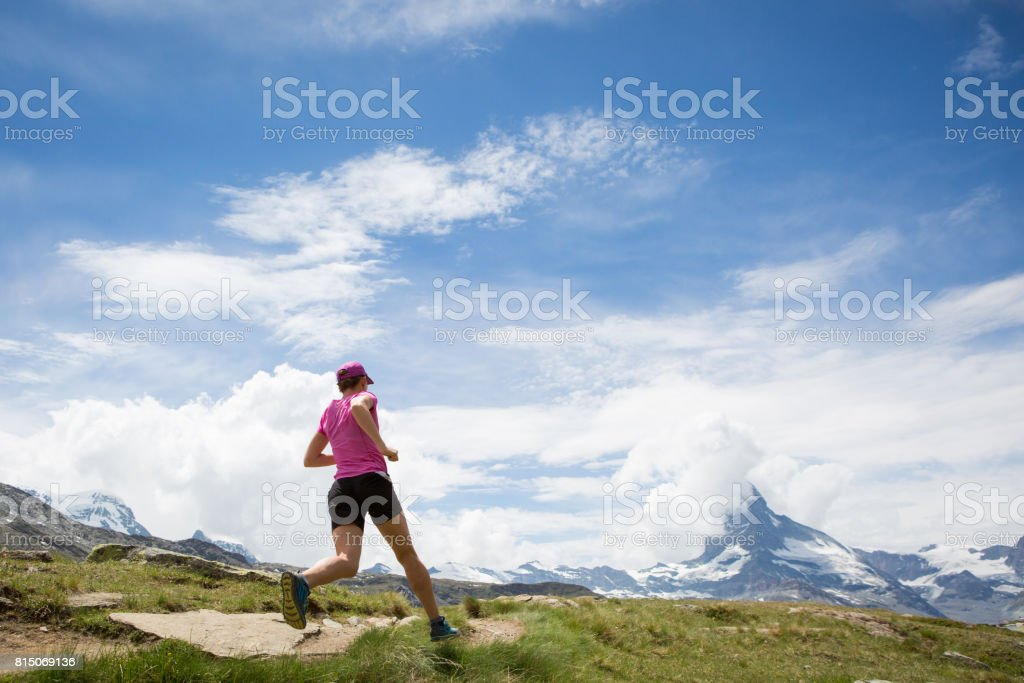 Female Running Fast in the Mountains stock photo