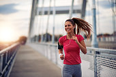 istock Female running in the city 1086946702