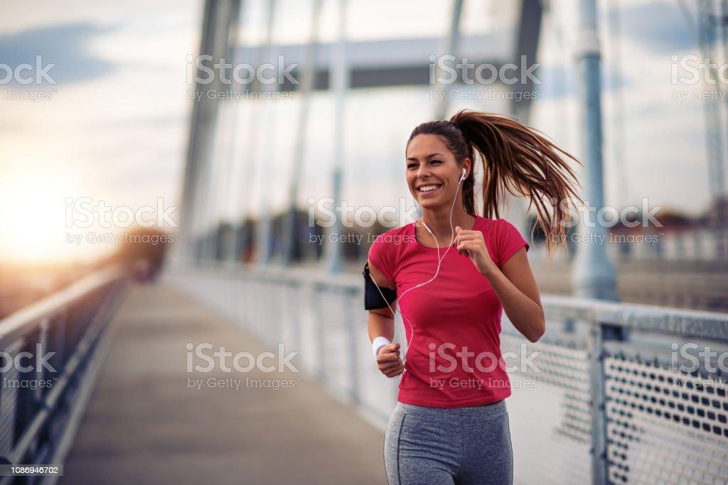 Female running in the city stock photo