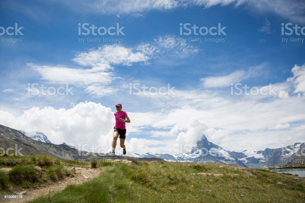 Female Running in the Mountains stock photo