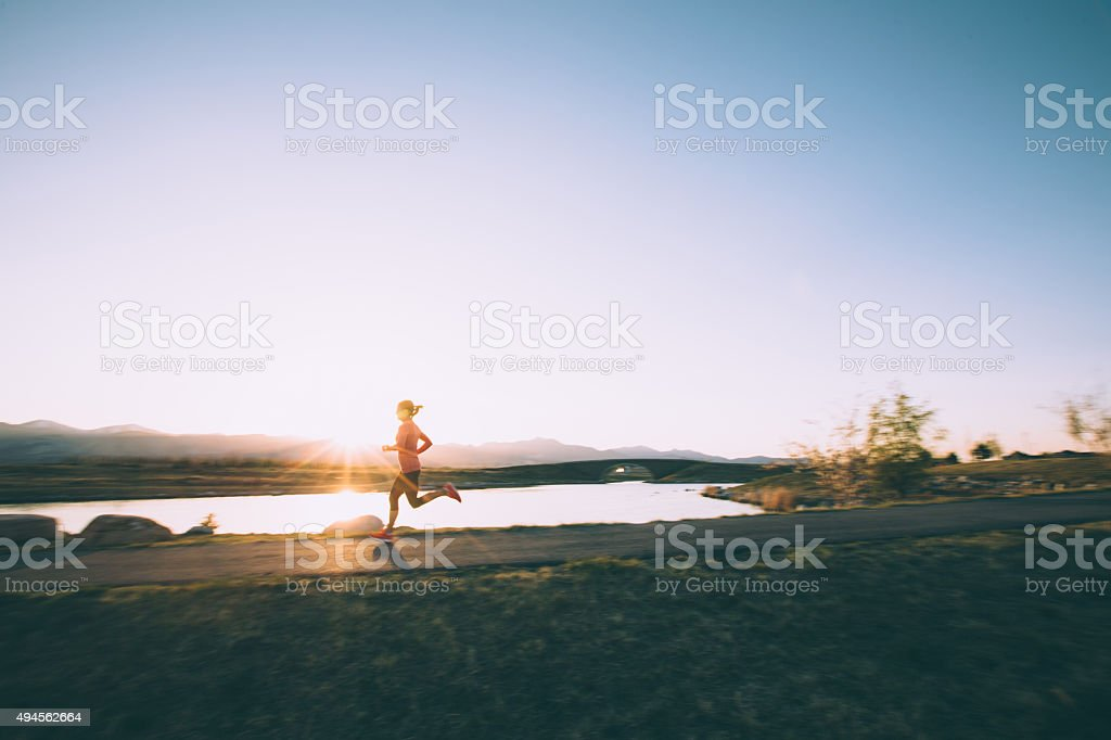 Female Running on Path During Sunset in Utah stock photo