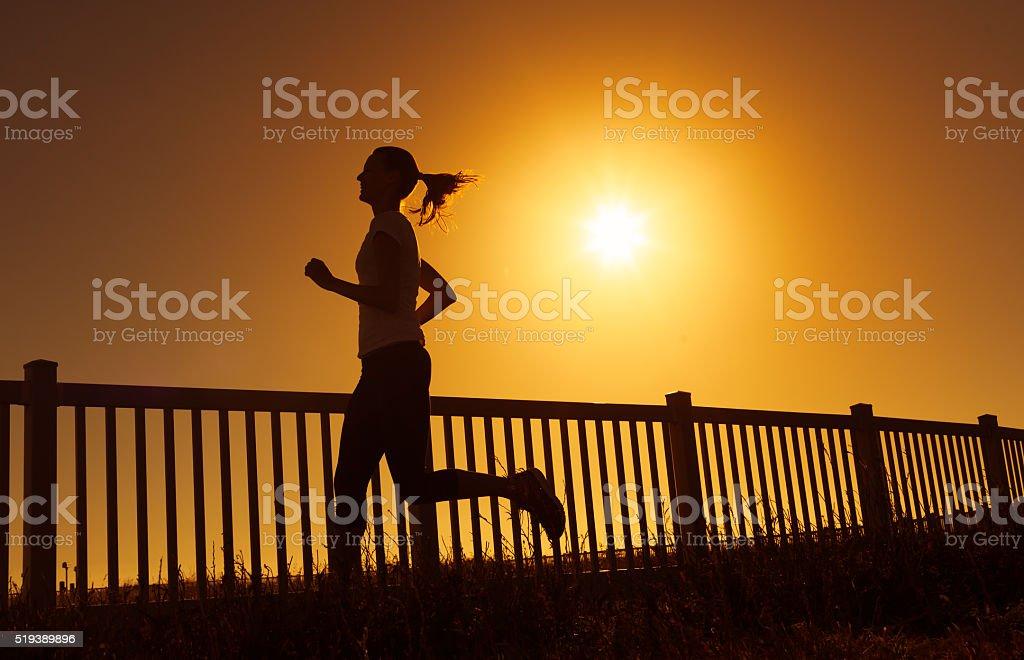 Female running stock photo