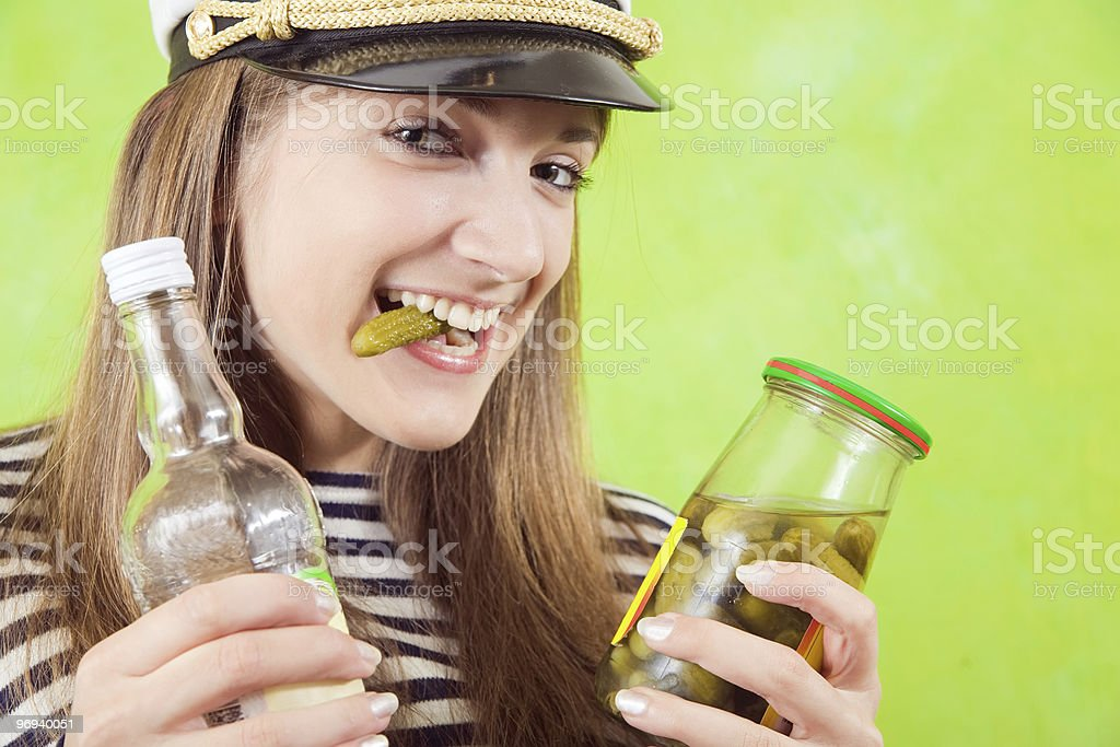 female sailor with bottle of vodka and pickle royalty-free stock photo