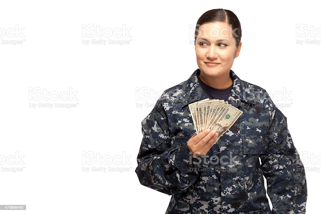 Female sailor with money looking away stock photo