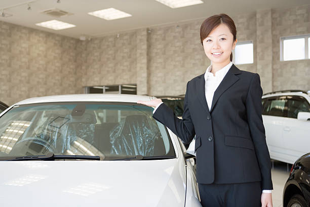 Female salesclerk of car dearlership stock photo