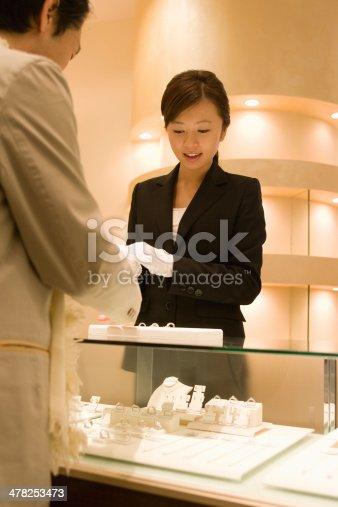 istock Female salesclerk taking care of customers 478253473