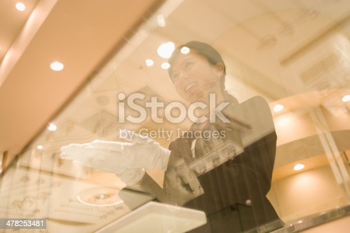 istock Female salesclerk taking care of customers 478253481