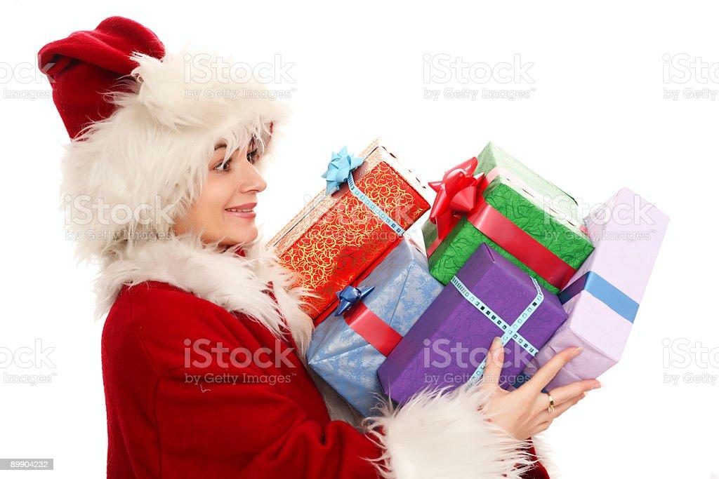 Female santa claus holding presents royalty-free stock photo