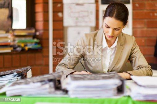 868148002 istock photo female school teacher working in office 157703235
