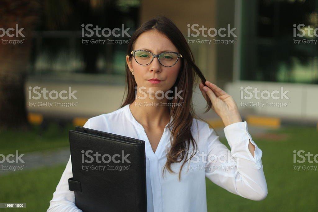 Female Schoolteacher on schoolgrounds - Stock Image stock photo