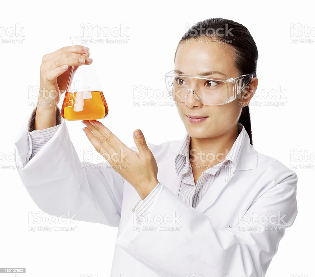 Female Scientist Analyzing Sample In Conical Flask - Isolated Asian female researcher analyzing a sample in the conical flask. Horizontal shot. Isolated on white. Adult Stock Photo