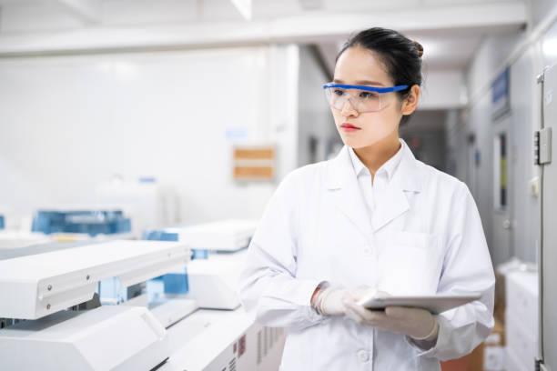 Female scientist in a medical laboratory stock photo