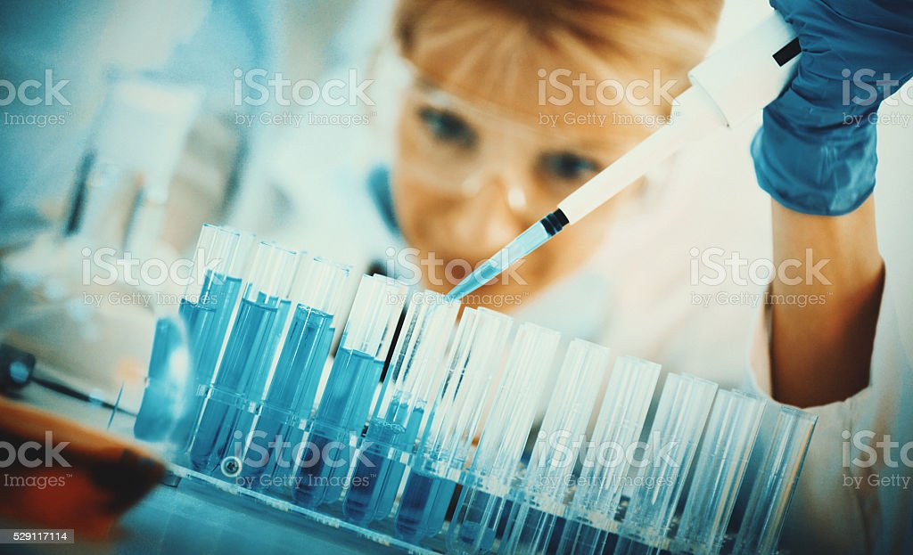 Female scientist in laboratory. stock photo
