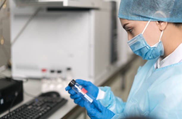 Female scientist looking at the scientific sample in the CDC laboratory. stock photo