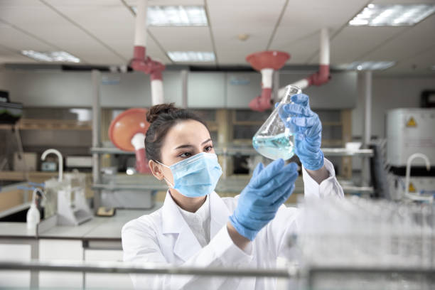 Female scientist looking at the scientific sample in the laboratory. stock photo