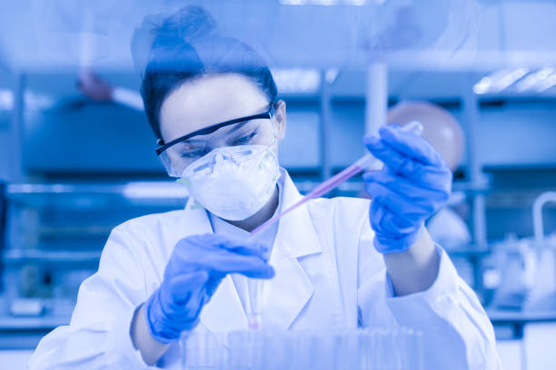 Female scientist working in the CDC laboratory. stock photo