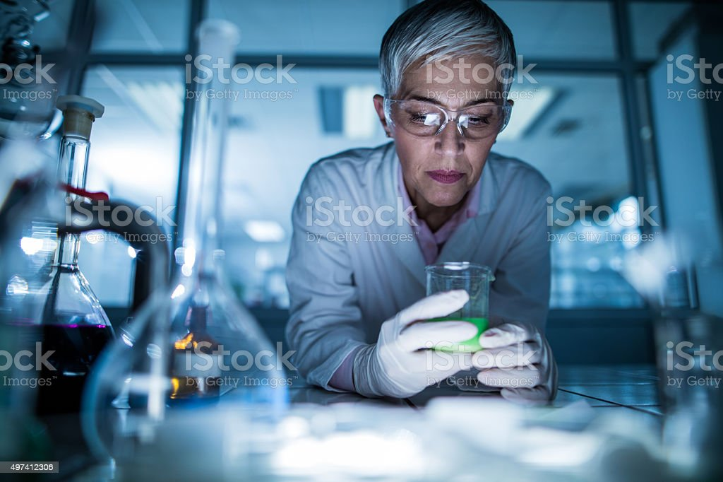 Female scientist working on a new scientific experiment. stock photo