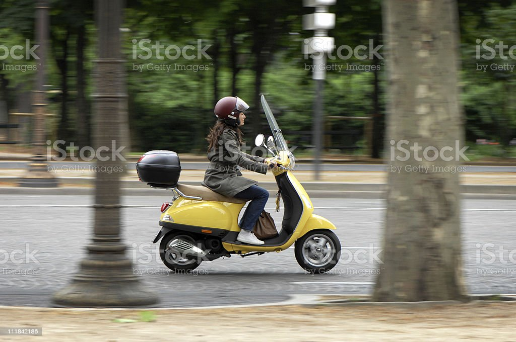 Female Scooter Rider in Paris France stock photo