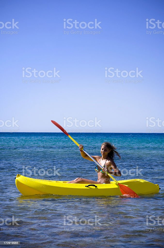 Female Sea Kayaker In A Bikini royalty-free stock photo