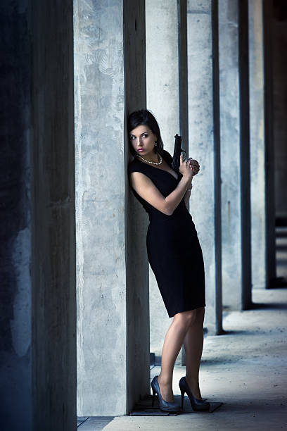 female secret agent in action - female spy stock photos and pictures