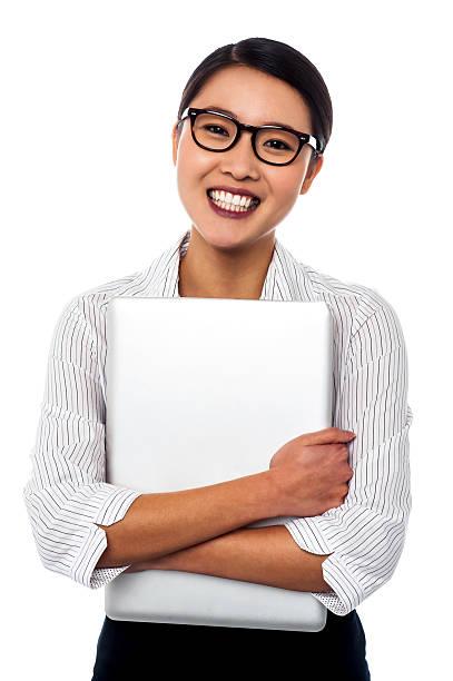 Female secretary holding laptop tightly stock photo