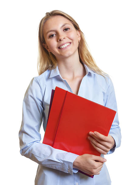 Female secretary with colorful paperwork laughing at camera stock photo