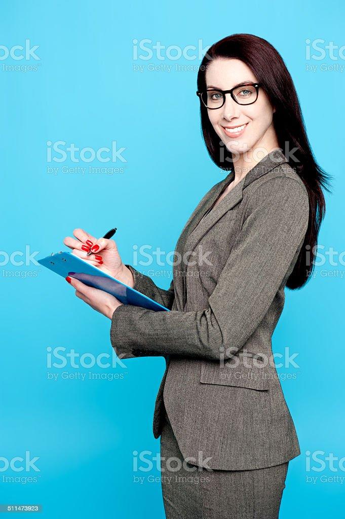 Female secretary writing business document royalty-free stock photo