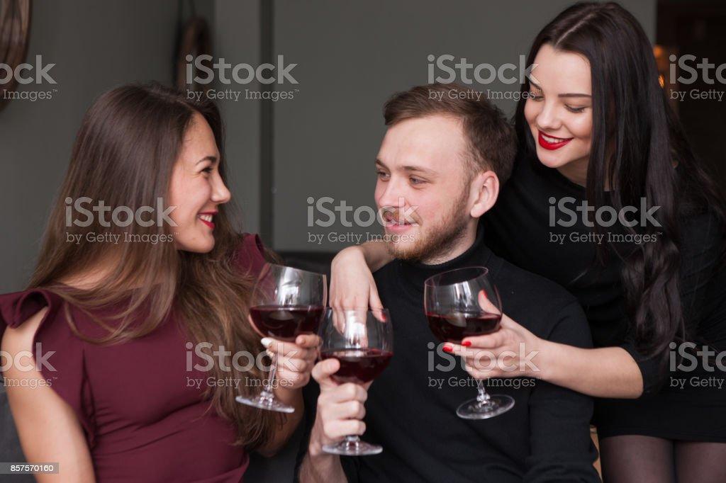 Female seduction at company party. Love triangle stock photo