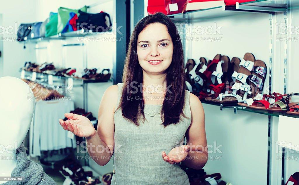 Female seller in shoes shop foto de stock royalty-free