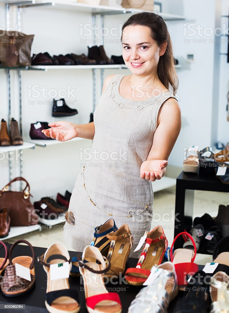 Female seller in shoes shop foto de stock royalty-free