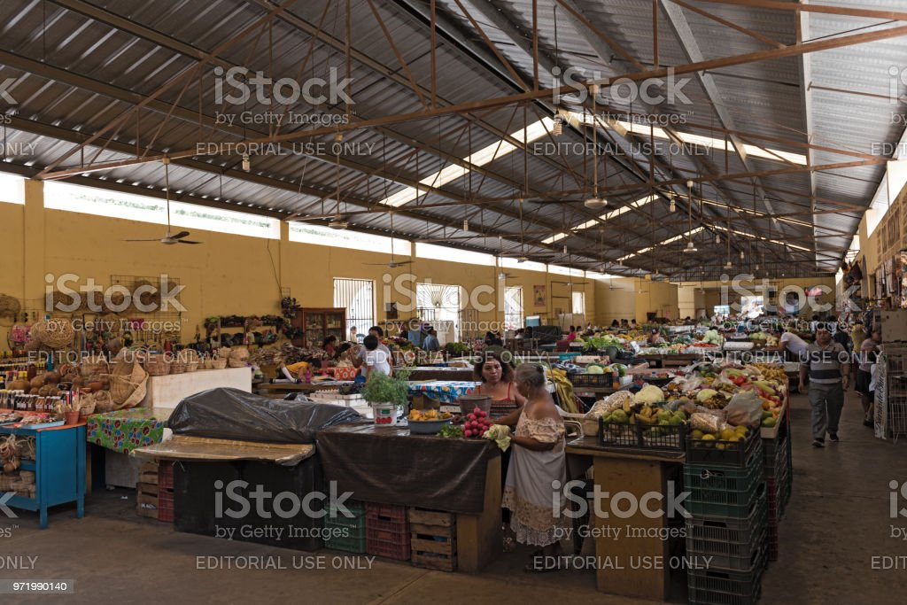 female sellers with customers at the main market, mercado municipal in valladolid,  mexico stock photo