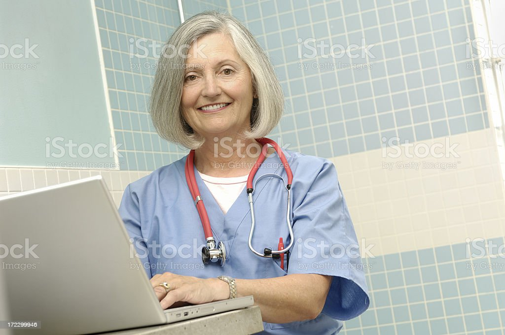female senior doctor with laptop low angle royalty-free stock photo
