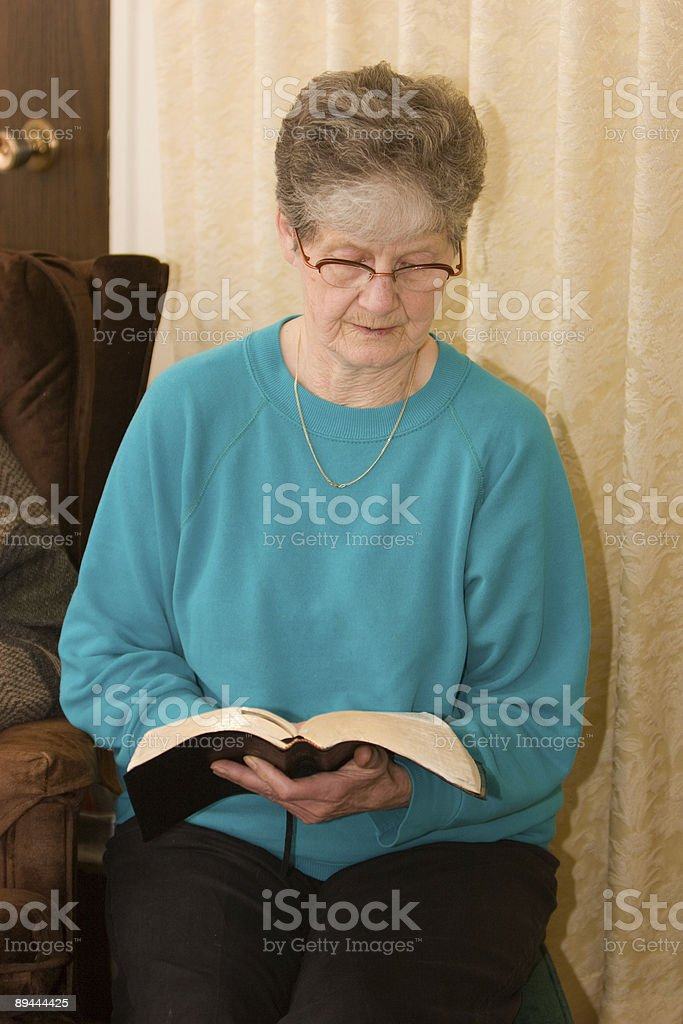 Female Senior Reading Bible royalty-free stock photo
