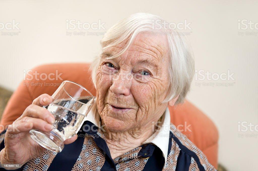 Female senior Woman Drinking Water royalty-free stock photo