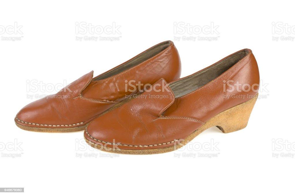 female shoes in orange heeled used on a white background stock photo