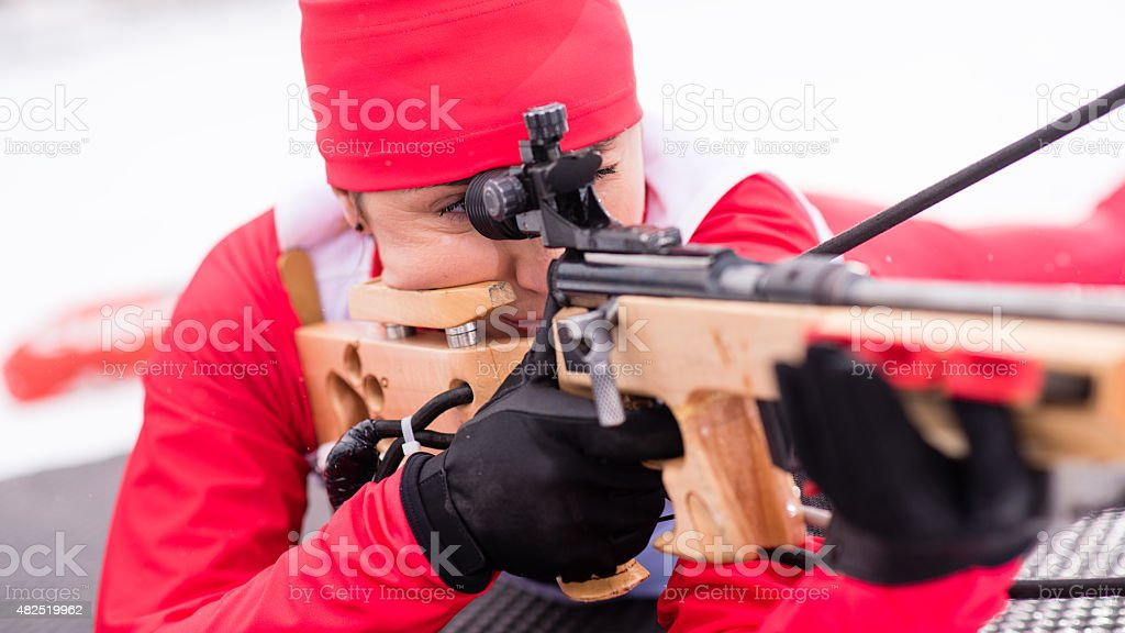 Female shooting at biathlon training stock photo