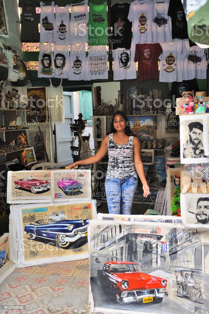 Female shop owner with souvenirs for sale, Old Havana, Cuba stock photo