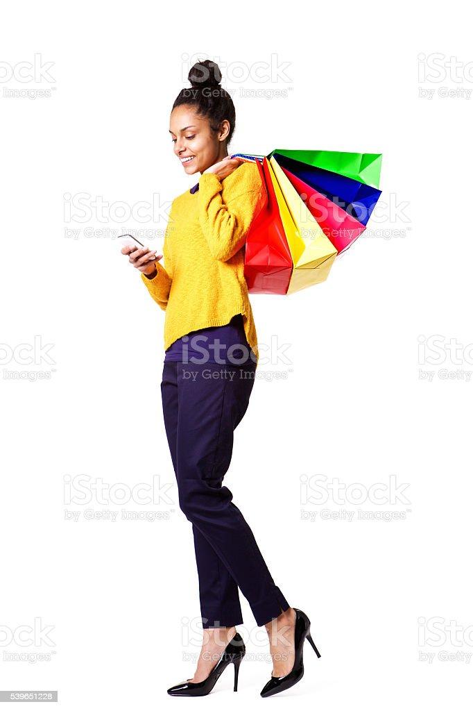 Female shopper using mobile phone stock photo